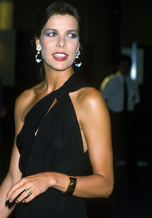 In 1985, Caroline rocked another version of the one-shoulder silhouette - this Grecian knot was simple and elegant. Loving the return of the blue eye shadow, too!