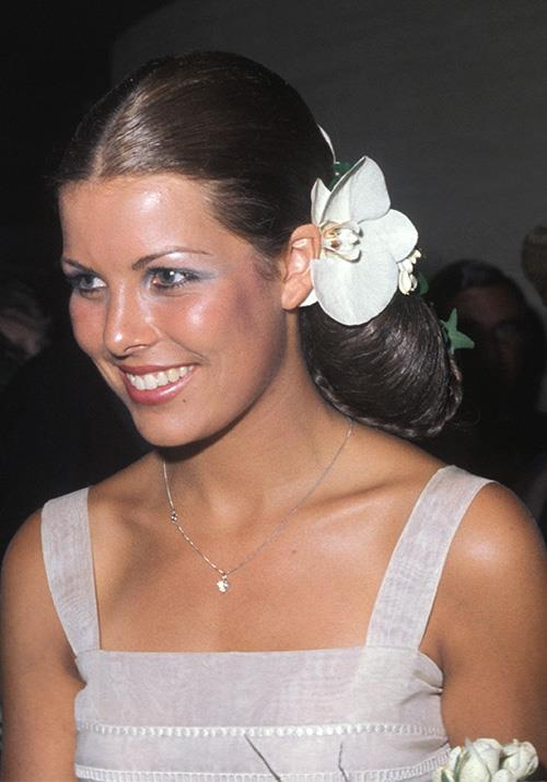 Caroline was also getting experimental with makeup at the time - a splash of blue eye shadow never hurt anyone.
