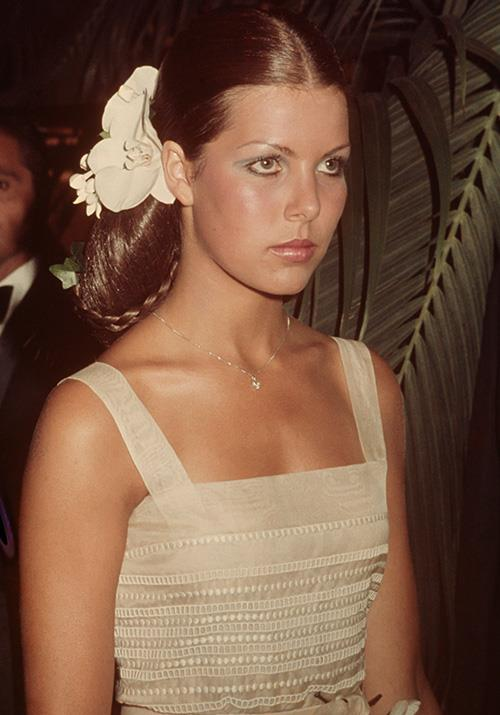 In 1974, the Princess attended the famed Red Cross Ball in Monaco, rocking an iconic 70s hairstyle to boot.