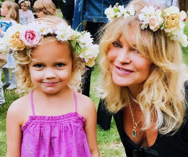 Goldie's Instagram feed is full of her sharing grandma moments, like this image of herself and adorable granddaughter, Rio as Rio graduated pre-school.