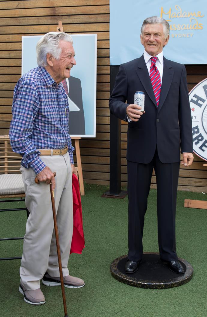 Celebrating his 88th birthday next to his wax figure holding a Hawkes Lager tinnie in Clovelly.