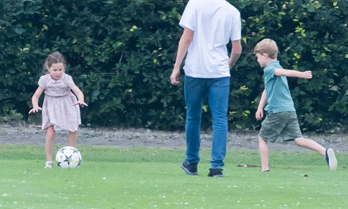 Prince George isn't shy about telling his sister that he's better than her at football.