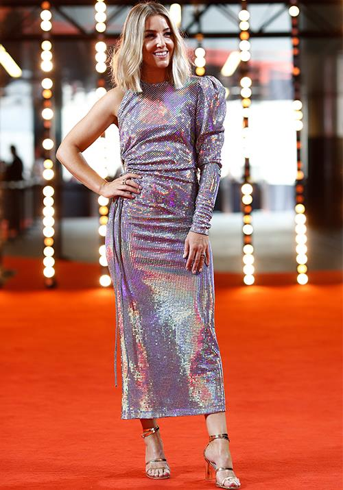 "Jules Sebastian is radiating all the colours of the rainbow in this one-shoulder design. She was one of the first to arrive - no doubt to cheer on her husband [Guy Sebastian](https://www.nowtolove.com.au/celebrity/celeb-news/jules-sebastian-guy-sebastian-delta-goodrem-60524|target=""_blank""), who is this year's host!"