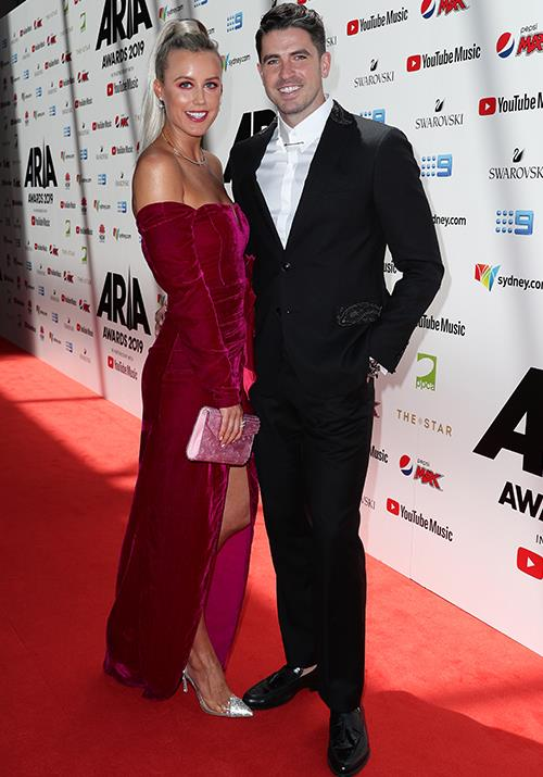 TV hosts Liv Phyland and Scott Tweedie pose up a storm for the red carpet.