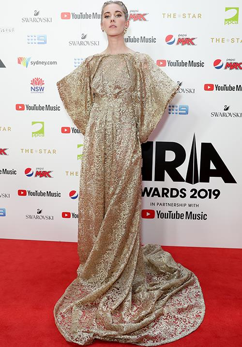 Singer Elle Graham, AKA Woodes is the ultimate golden girl in this heavenly frock.