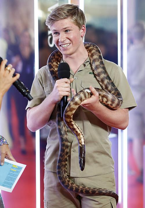 You can count on Rob Irwin to make this Australian spectacle even *more* Australian. The 15-year-old is casually rocking a snake as an accessory. No big deal...