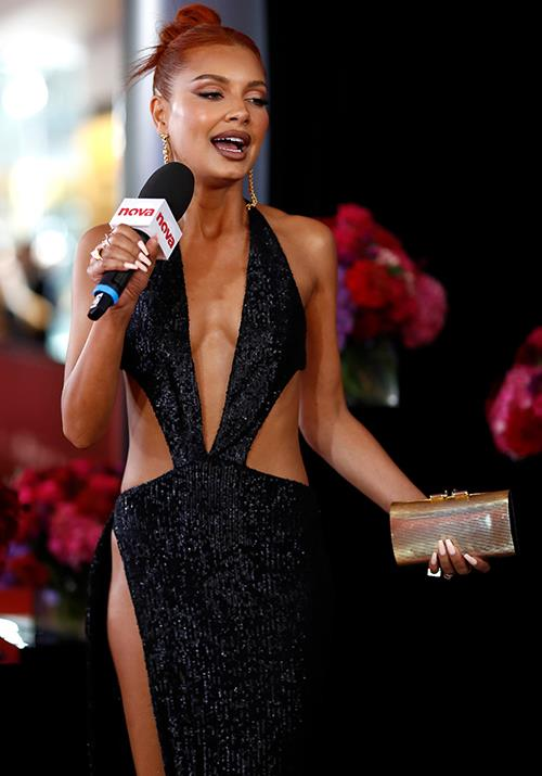 Aussie DJ Havana Brown rocks a cut-out like no other in this black sequined dress.