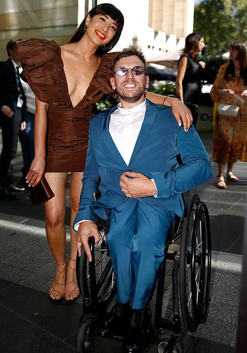 Iconic Aussie sportsman Dylan Alcott rocks an 80s esque ensemble for the music event - very apt!