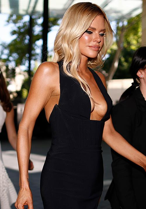 Sophie Monk is as glammed up as ever in this fitted black dress - that highlighter!