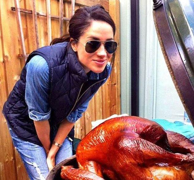 Meghan posing with a Thanksgiving turkey back in 2016.