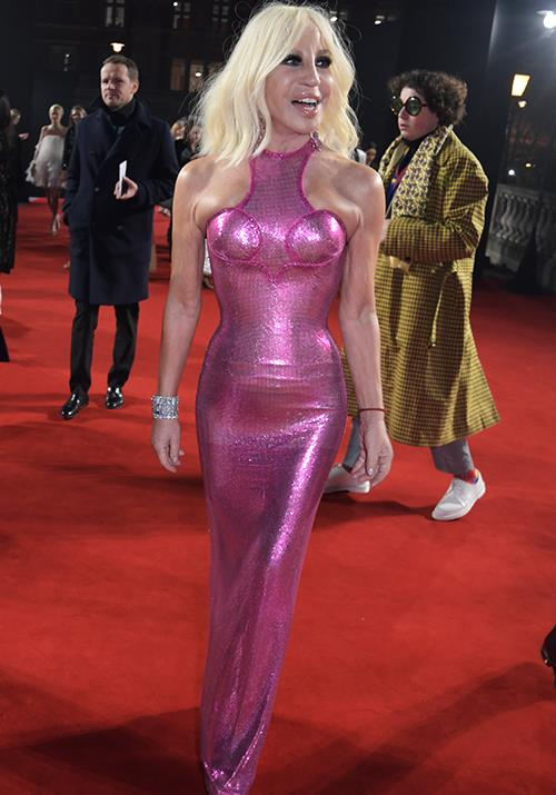 Ever the fashion maven, Donatella Versace  single-handedly put on a fashion spectacle for us in this bold pink number.