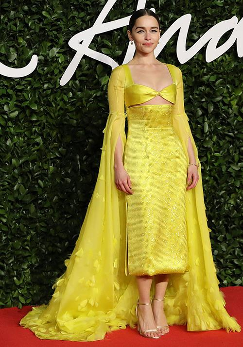 *Last Christmas* actress Emilia Clarke stood out from the crowd in this zesty yellow number.