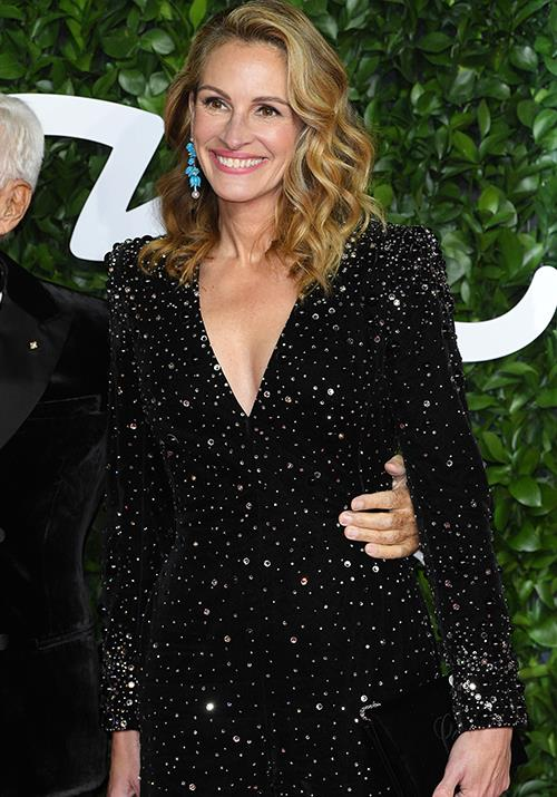 Julia Roberts is as glowy as ever in this sparkly black number.