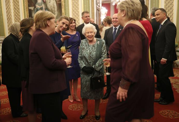 The Queen has hosted an official reception for NATO leaders - including Donald Trump - at Buckingham Palace.
