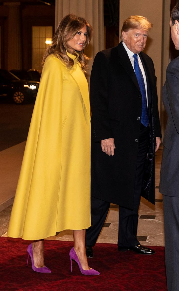 Meanwhile Melania Trump came dressed in a standout yellow cape coat.