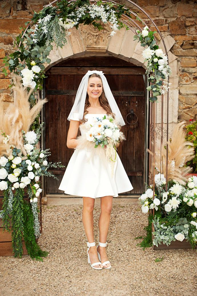 """Here comes the bride! April reveals she was unable to wear thermals in the cold climate, due to her """"minimal"""" dress."""