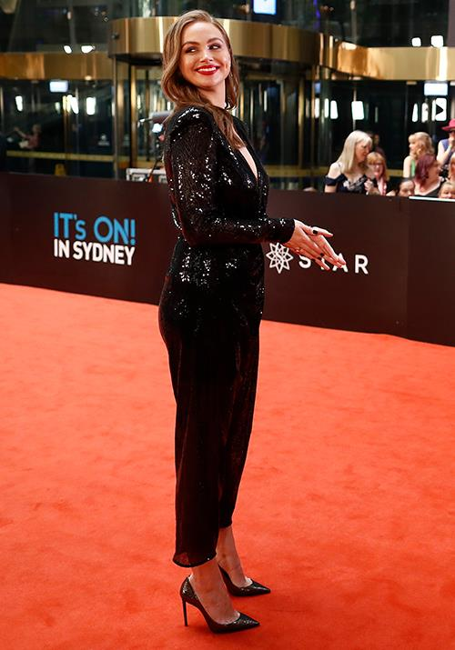 *E!* Australia host Ksenija Lukich brings a touch of shimmer in this glitzy black jumpsuit.