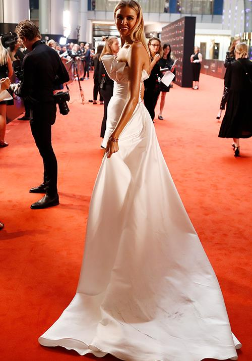 Tegan Martin is angelic in this white gown - complete with a bridal-worthy train.