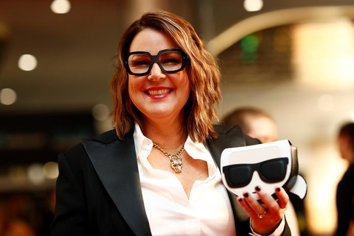 TV host Julia Morris rocks a couple of pairs of glasses for her red carpet ensemble.