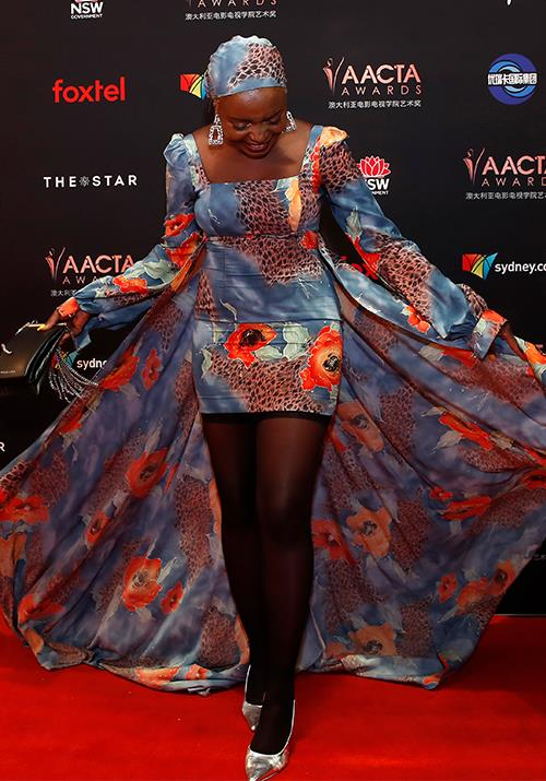 Now that's a train! Actress Suzan Mutesi is an absolute vision in this mini printed number.