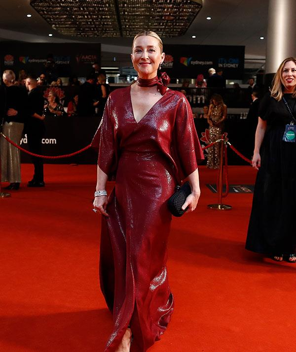 Asher Keddie was the ultimate lady in red with this plunging number.