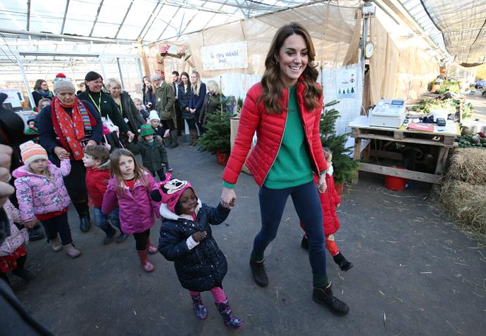 Kate looked utterly Christmassy as she led children to pick out a Christmas tree.