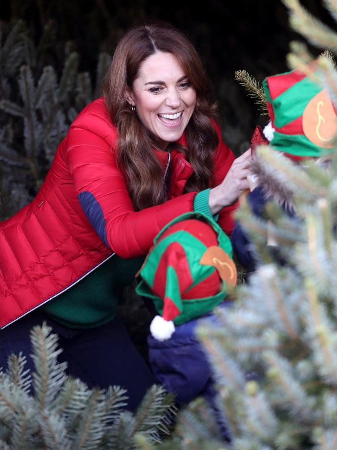 The Duchess of Cambridge was all smiles as she helped children pick out their Christmas trees.