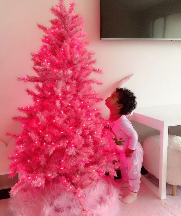 "**Khloe Kardashian** <br><br> There's no way Khloe Kardashian would choose a simple Christmas tree. She shared this shot of daughter True and a bright pink tree. ""It's safe to say that True loves it!!! Thankful and blessed beyond words!"" Khloe wrote."