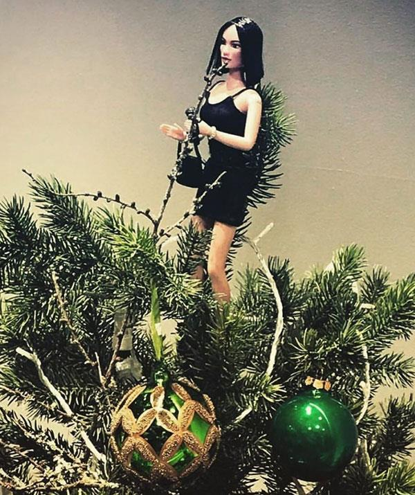 **Victoria Beckham** <br><br> There's no better tree-topper than this! Victoria Beckham channelled her inner Spice Girl by swapping a star or an angel for a Posh Spice figurine. Love!