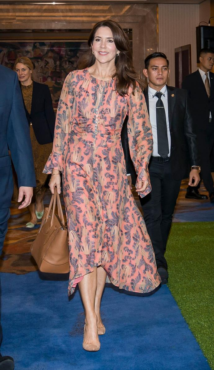 While visiting Indonesia's capital city, Jakarta for World AIDS Day, Crown Princess Mary chose to re-wear to her trusted H&M frock from the retailer's Concious Collection, made from organic and recycled fabrics.
