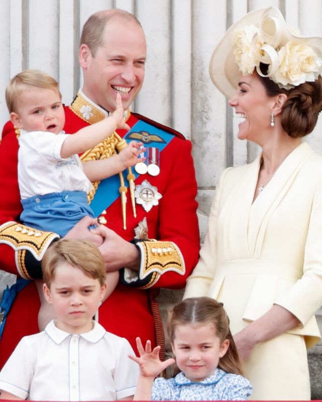 Kate and William sharing a sweet moment with Prince Louis at Trooping the Colour earlier this year, as Prince George and Princess Charlotte look on.