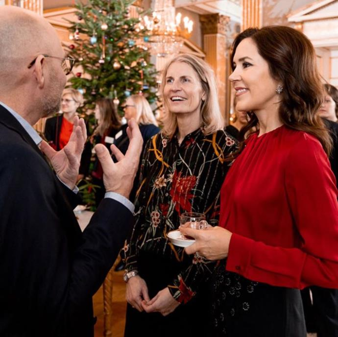 Crown Princess Mary hosted a Christmas reception for staff and partners of the Mary Foundation at Amalienborg Palace. That Christmas tree in the background is looking splendid!