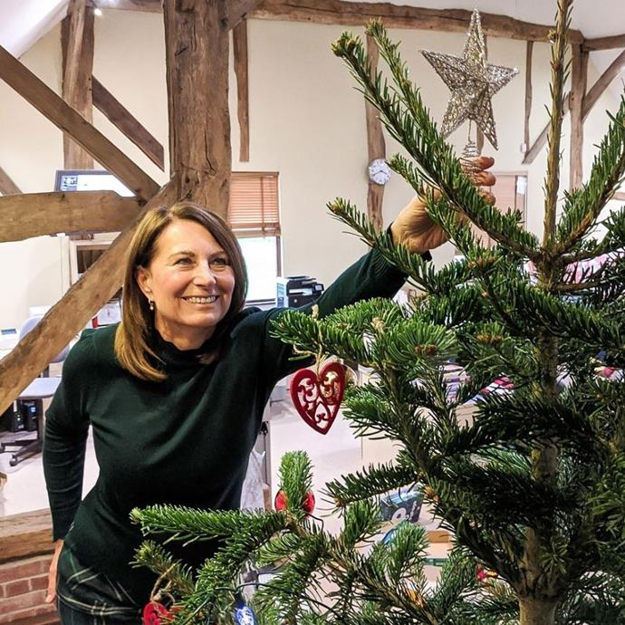 Meanwhile Duchess Catherine's mum Carole Middleton is getting into the festive spirit by decorating her office Christmas tree.