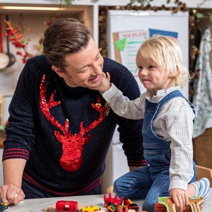 Reindeer jumper? Check? Adorable sous chef? Check. Jamie Oliver is all set for his Christmas TV special.