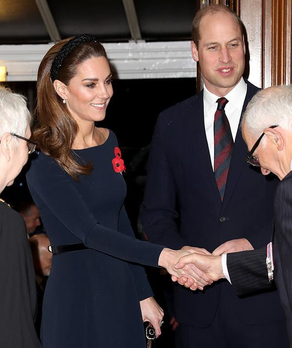Kate Middleton paired a chic Zara headband with her elegant navy dress.
