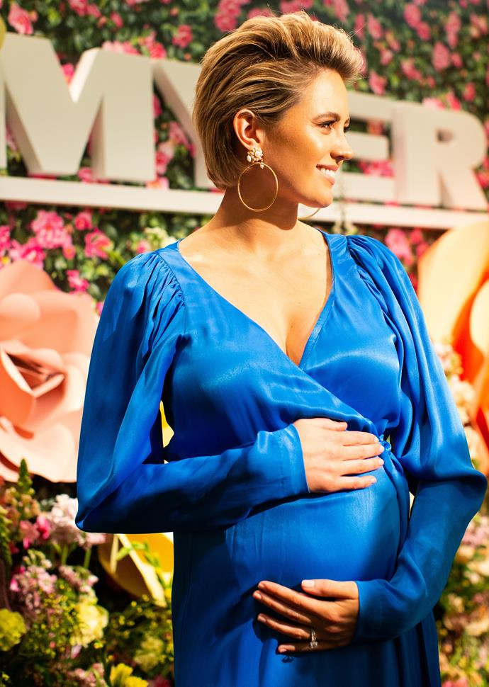 Jesinta cradled her baby bump protectively for her first public appearance while pregnant.