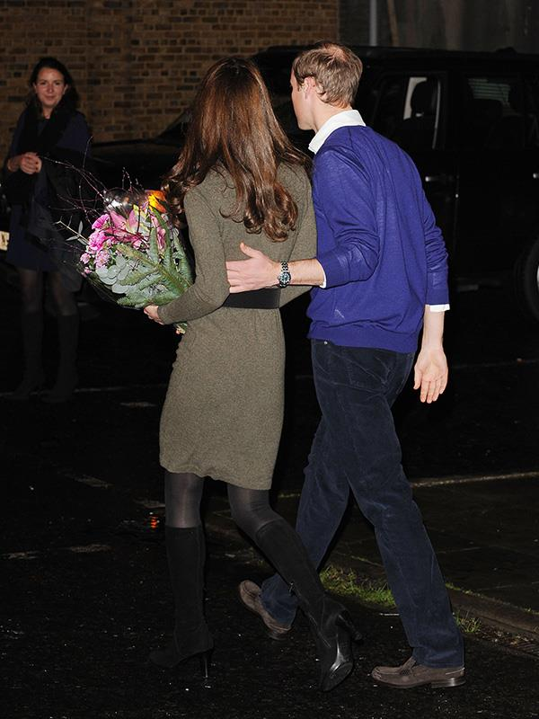William placed a protective hand on Kate's back, guiding her away from photographers in 2011.
