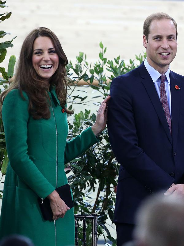 Kate placed a warm hand on William's shoulder in 2014.