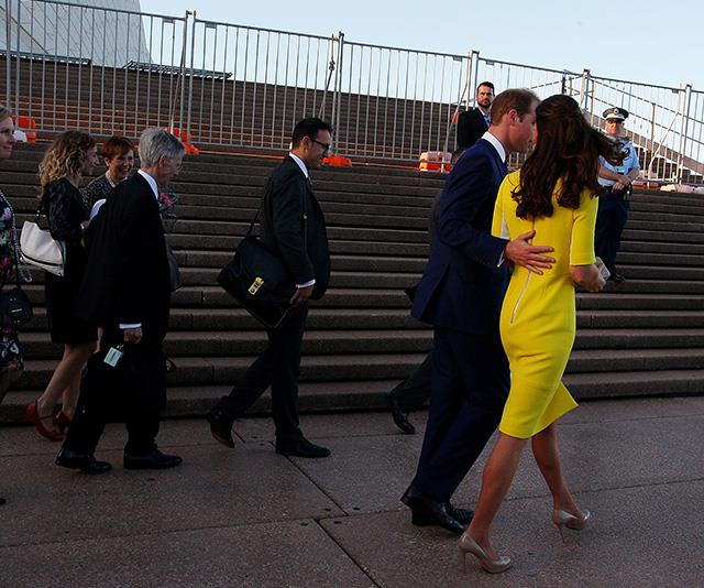 The protective hand was back during a visit to Australia in 2014.