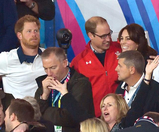 Third wheel, Harry? The Duke of Sussex looks a bit left out of the Cambridge couple's fun here!