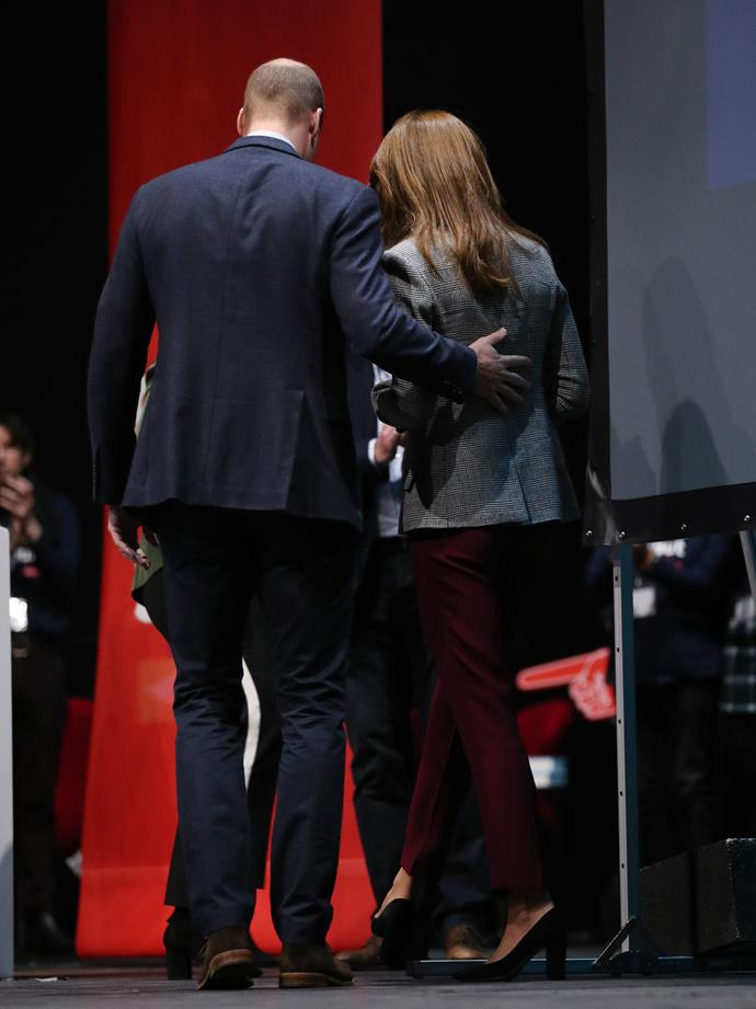 Prince William places a protective hand on Kate's back during a recent royal engagement.
