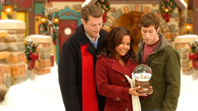 **Snowglobe (2007)** <br><br> Angela (Christina Milian) discovers a Christmas-themed dream world inside a magical snowglobe.