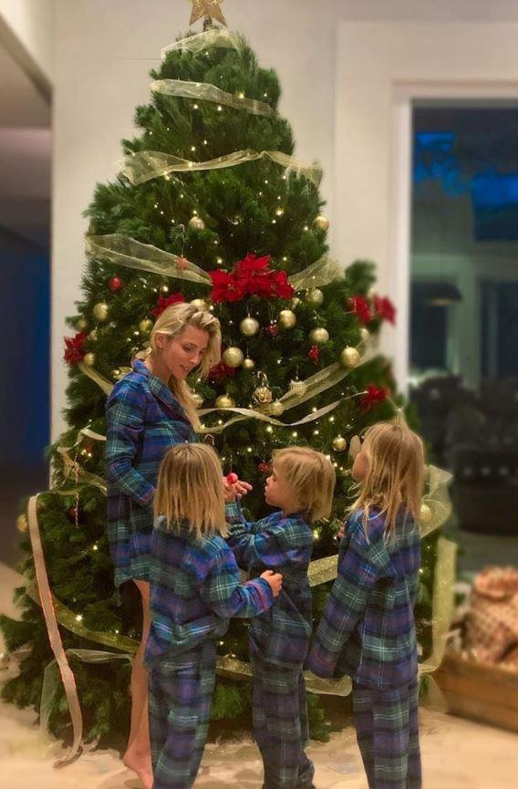 We didn't think we could love Elsa Pataky any more but here she is with her three kids India Rose, seven, and twin sons Tristan and Sasha, five in matching plaid pyjamas.