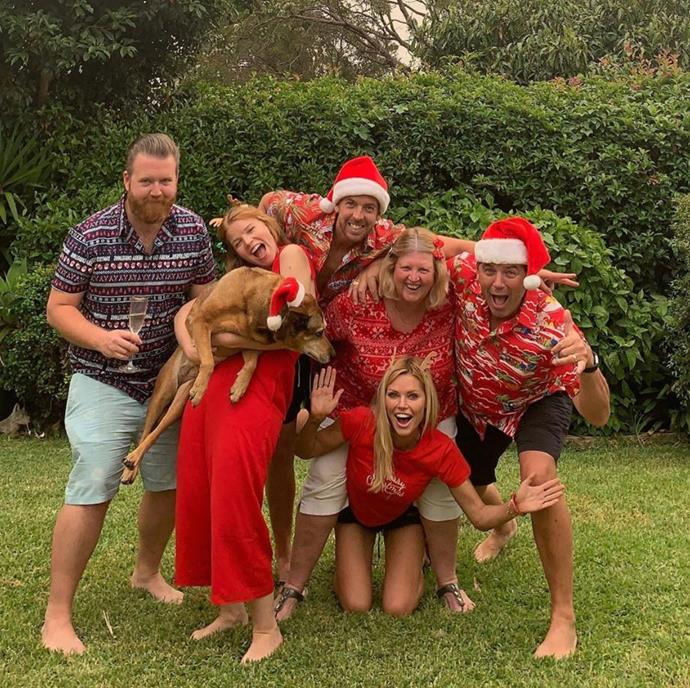 Sophie Monk and her boyfriend Joshua Gross posed for a very Aussie family Christmas photo. But the reality of taking the photo wasn't as smooth as you'd expect.