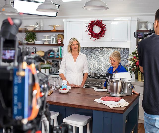 Nicole Byers (left) and *The Australian Women's Weekly's* food editor Fran Abdallaoui (right), preparing to film a Christmas cooking segment.