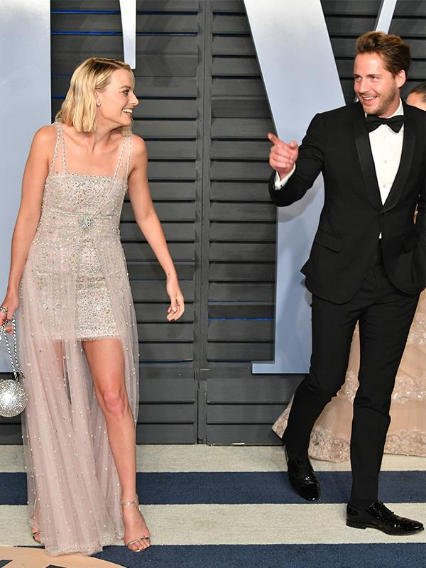 Margot and Tom sharing a laugh together at the Vanity Fair Oscars Party in 2018.