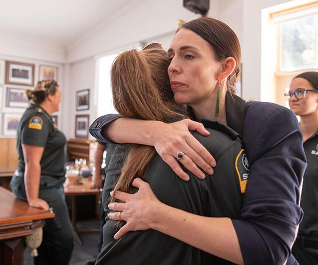 New Zealand Prime Minister Jacinda Ardern hugs on of the first responders.