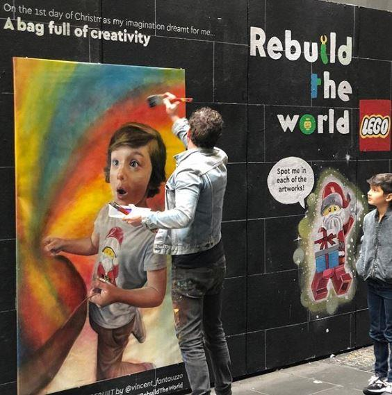 Vincent and Luca work on their mural in Melbourne.