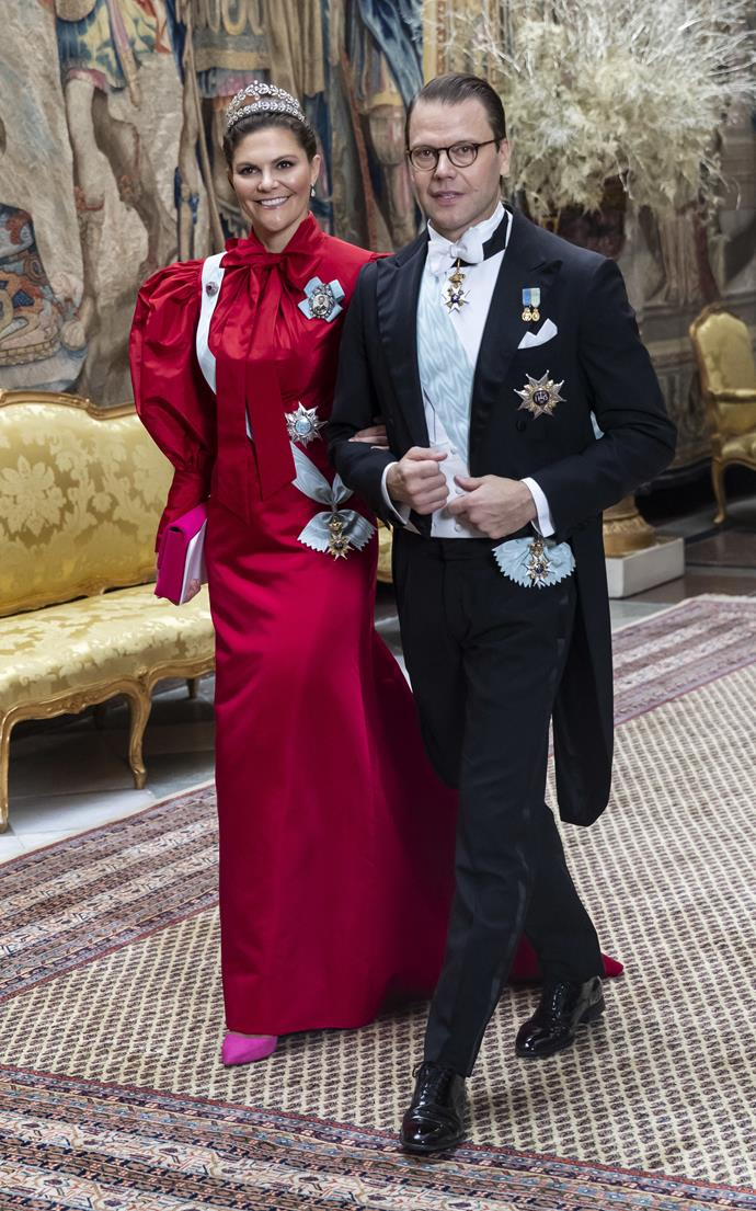 The Swedish royal paired bright pink shoes to finish the look.