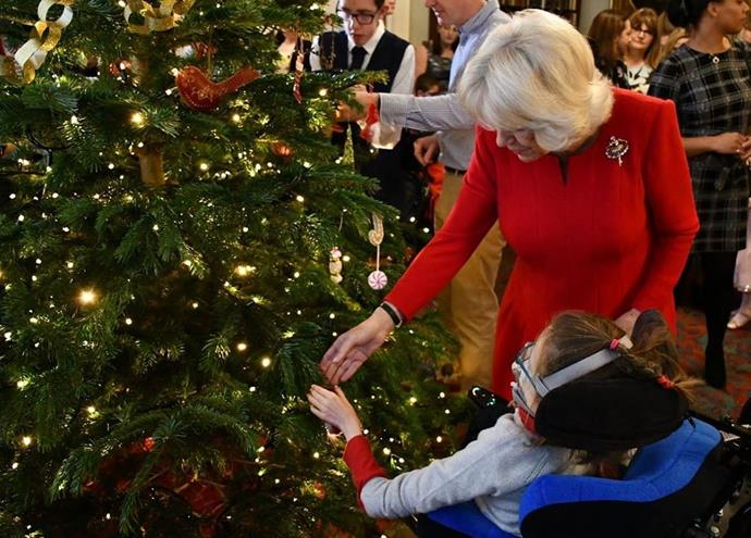 Christmas is in the air at Clarence House! Duchess Camilla invited children from two of her charity patronages to decorate the Christmas tree and meet some reindeer.